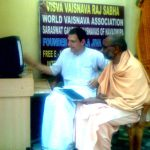 Premkumar das helping sannyasis to set up Email accounts in the WVA Office Mayapur.