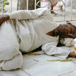 Vaishnava taking rest at Samadhi Mandir of Srila Bhaktisiddhanta Sarasvati Thakur in Mayapur