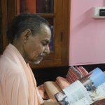 Srila Bhaktivedanta Paryatok Maharaja receiving new WVA magazine