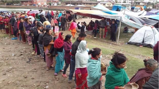 People line up for prasadam (sanctified food) provided by devotees of the ISKCON Katmandu community.