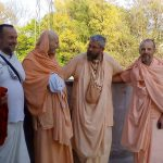 Pujyapad Muni Maharaj and Pujyapad Narasimha Maharaj discussing the glorious celebration of 100 years of Gaudiya Math.
