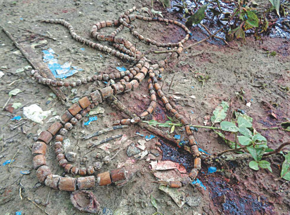 The rosaries of Hindu priest Shymananda Das lies amid blood stains on the spot where he was hacked to death early yesterday.