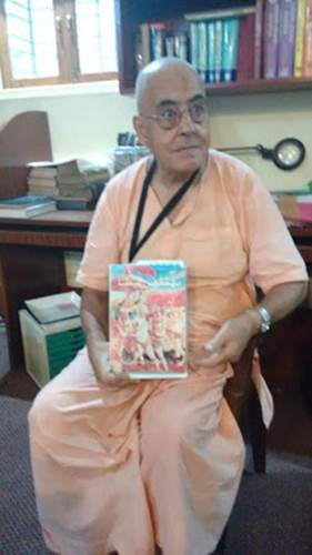 H.G. Ravanari Prabhu at BRC Library. He is holding Arabic Bhagavad Gita